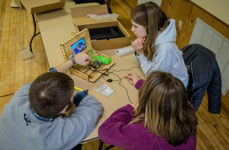 Students learn programming in the classroom through WVU extension programs.