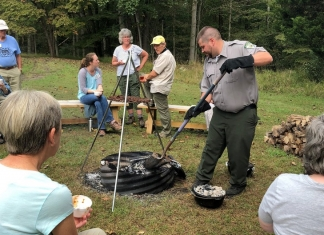 A park ranger demonstrates fire-pit cooking at North Bend State Park near Cairo, West Virginia