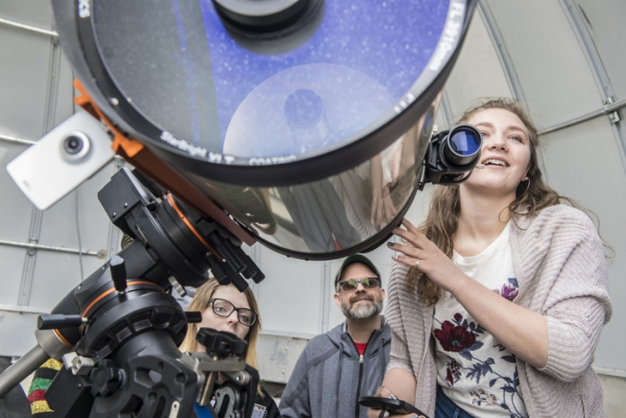 Professor Kathryn Williamson and students use the 14-inch telescope at White Hall.