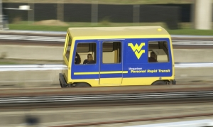 Students ride the PRT at West Virginia University between the Downtown and Evansdale campuses at Morgantown, West Virginia.