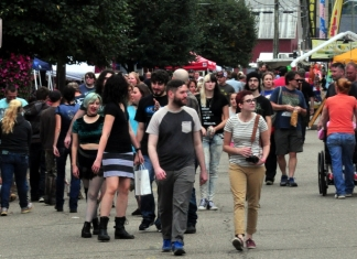 Fans of the Mothman wander Main Street during the Mothman Festival at Point Pleasant, West Virginia.