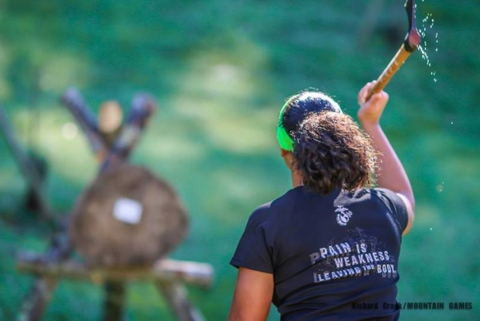 A competitor throws a tomahawk during the annual Mountain Games competition at Heritage Farms near Huntington, West Virginia.