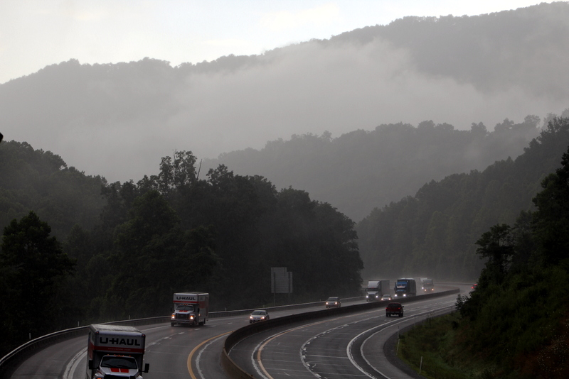 Motorists navigate the West Virginia Turnpike in Fayette County during a summer downpour.