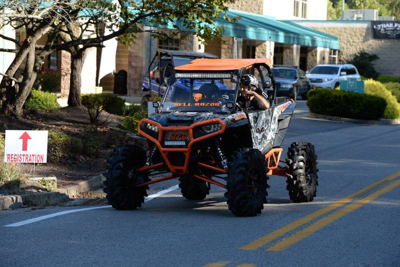 ATVs parade through Gilbert, West Virginia, during National Trailfest.