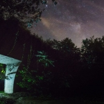 """The night's sky opens over a bunker entrance in the """"TNT Area,"""" alleged lair of the Mothman, near Point Pleasant, West Virginia."""
