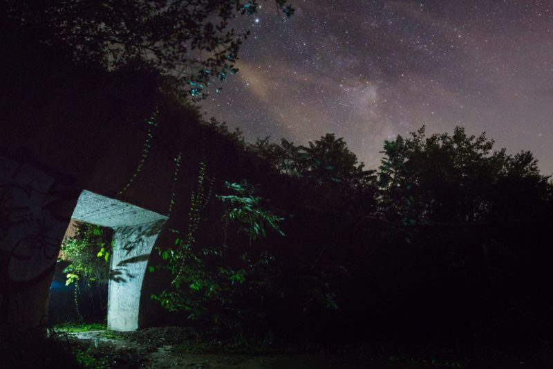 "The night's sky opens over a bunker entrance in the ""TNT Area,"" alleged lair of the Mothman, near Point Pleasant, West Virginia."