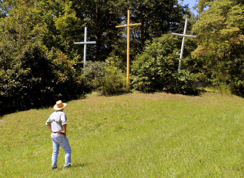 Coffindaffer's Crosses rise from a small island in the Kanawha River at Gauley Bridge, West Virginia.