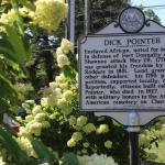 A historic marker recounting a version of the Dick Pointer tale stands near his monument.