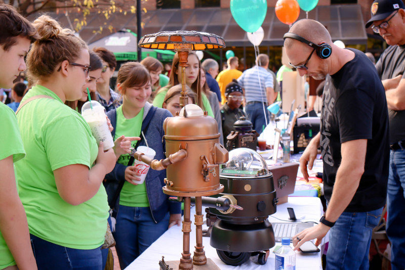 Exhibitors explain their craft at the West Virginia Makes Festival.