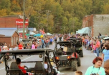 ATVs parade through Gilbert, West Virginia, during National Trailfest.