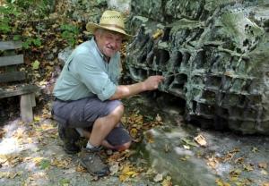 David Sibray explores boulders along the Honeycomb Rocks Trail in Pocahontas County, near Marlinton, West Virginia.
