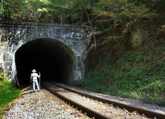 David Sibray peers into the Jenny Gap Tunnel near Lester, West Virginia, in Raleigh County.