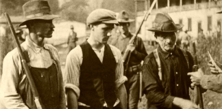 Miners are armed for battle during the West Virginia Mine Wars.