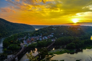 The sun sets beyond Harpers Ferry, West Virginia, as seen from the Maryland Heights overlook.