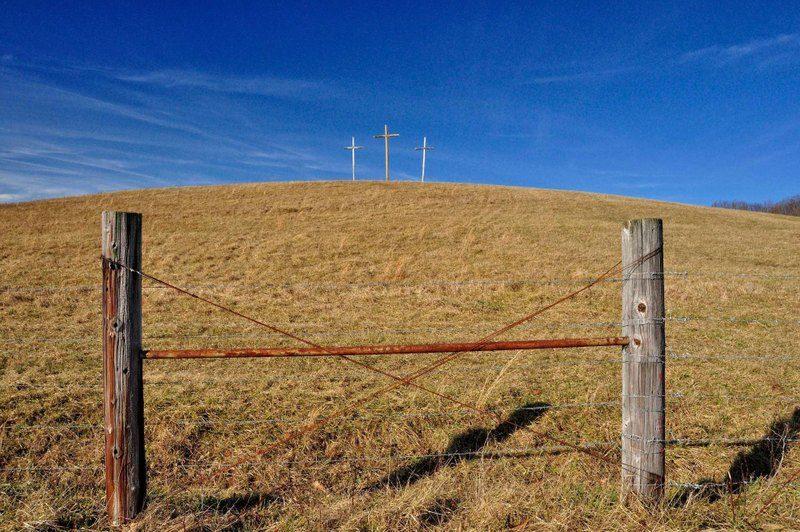 Three crosses rise in a West Virginia pasture.