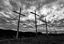 Three crosses rise along a West Virginia ridge.