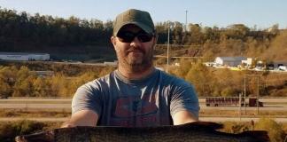 Matt Born displays the state record chain pickerel taken in 2019 at Upper Deckers Creek Lake.