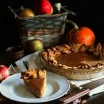 Pumpkin pie sits ready on a sideboard.