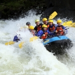 Rafters splash through a Gauley River rapid during Gauley Season.
