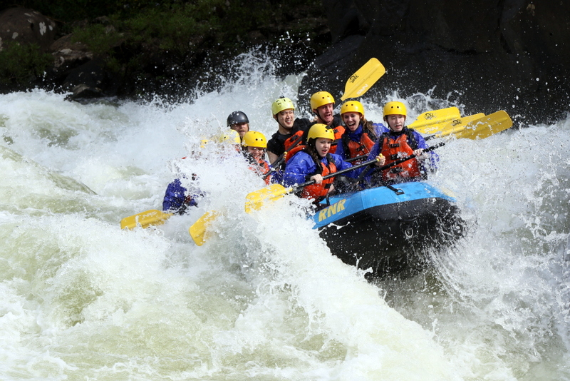 A raft launches into the Gauley River during an exciting excursion with River Expeditions.