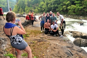 Rafters with River Expeditions stop for a group photo at Sweets Falls on the Gauley River. (Photo: RaftingInfo.com)