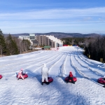 Snow tubers prepare for a run at Snowshoe Mountain.