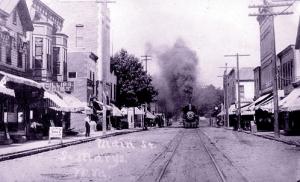 Undated photo showing engine chugging through downtown Saint Marys, c. 1905.