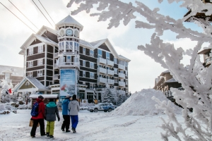 Families gather at Snowshoe Mountain, where new energy-saving measures are being instituted.