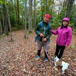 Hikers and their leashed companion hike at Dolly Sods in the Monongahela National Forest.