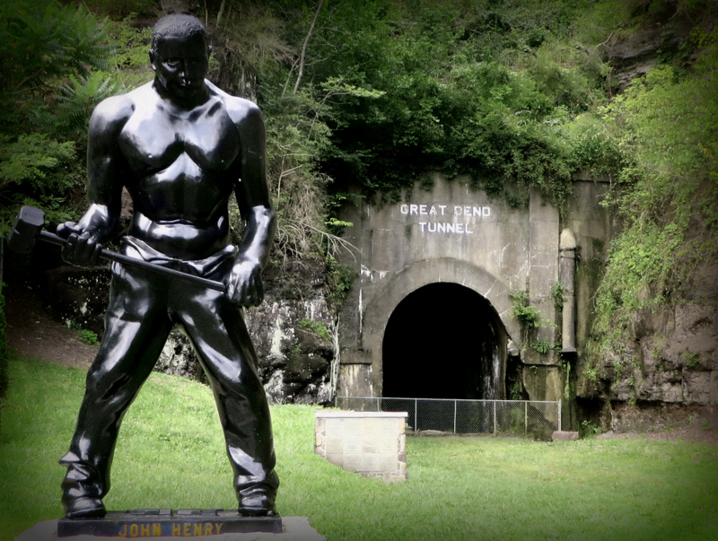 A statue of folk hero John Henry stands outside the Big Bend Tunnel.