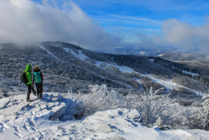 Hikers on Bald Knob survey they ski area at Canaan Valley Resort State Park.
