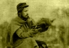 Union soldier Larkin Goldsmith Mead holds a Thanksgiving turkey at Camp Griffin, Virginia, c. 1861.