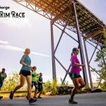 Runners jog beneath the New River Gorge Bridge.
