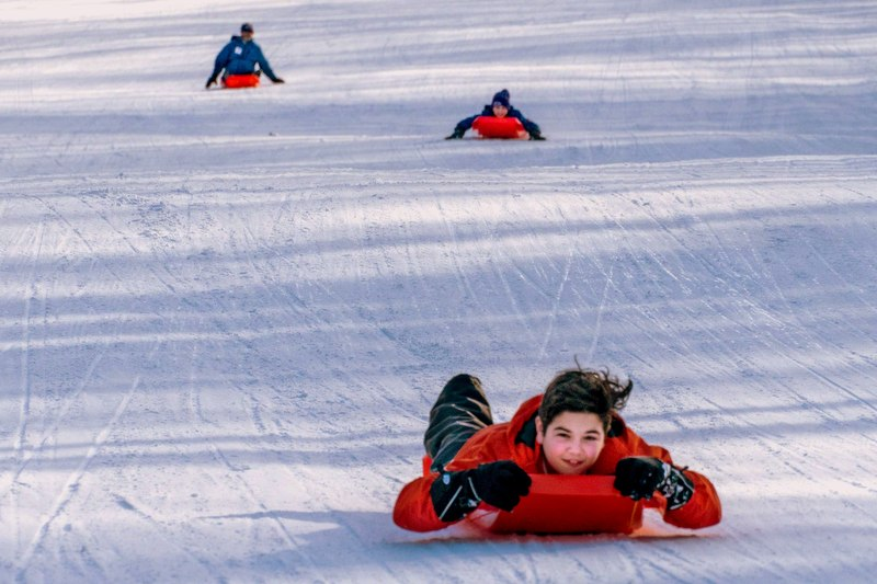 A young sledder barrels along the sled run at Blackwater Falls State Park.