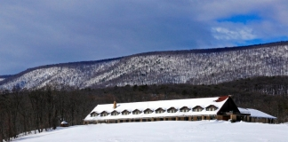 Great Cacapon Mountain rises behind Cacapon State Park Lodge on a winter day. (Photo courtesy W.Va. Dept. of Commerce)
