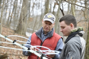 Jamie Schuler (left), associate professor of silviculture, teaches a WVU student about maple syrup production.