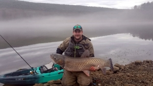 Zachary Adkins of Cabins caught a 53.1-inch,-59-pound grass carp at Warden Lake in Hardy County.