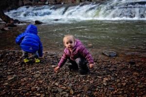 The Wolff children explore a pebbly beach along Paint Creek.