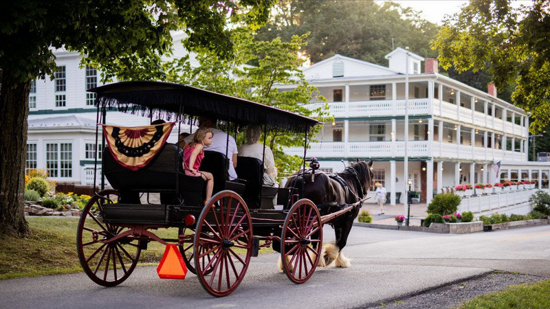 A horse-drawn carriage tours the historic ground of Capon Springs Resort.