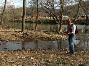 David Sibray surveys the mouth of Old Woman Run at Sutton, West Virginia.