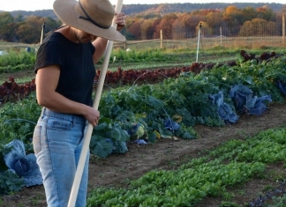Farm manager Susanna Wheeler tends a garden at New Roots Community Farm near Fayetteville, West Virginia.