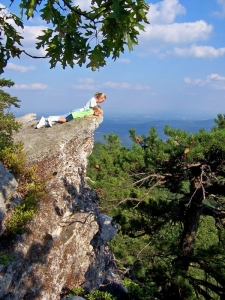 Young guests of Capon Springs Resort peer over a crag on the summit of Great North Mountain.