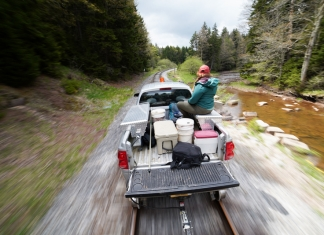 A trout-stocking truck follows a stream into the Allegheny highlands in West Virginia.