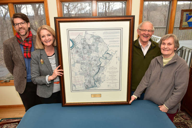 Dr. James Broomall and Monica Lingenfelter flank a map with Bill and Bonnie Stubblefield.