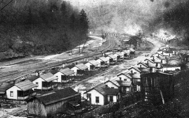 Camp houses line a road along Mate Creek in Mingo County, West Virginia.