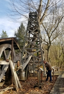 Historian David Sibray explores the restored oil well at Burning Springs, West Virginia.