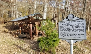 A historic marker at Burning Springs reveals more of the tale of the community's destruction.