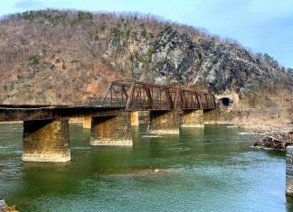 The footbridge over the Potomac at Harpers Ferry was damaged during a derailment (at left). NPS Photo: Autumn Cook