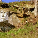 The rock face has been carved along a line f cliffs that crops out atop area hillsides.