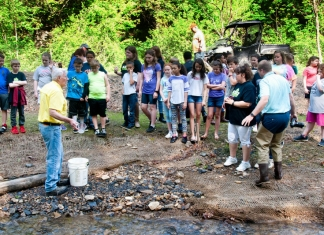 West Virginia students learn about trout habitat during a field trip.